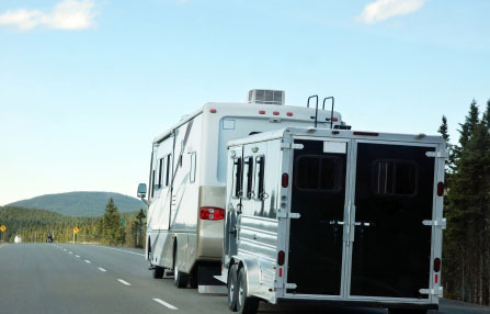 RV hauling a trailer on the road