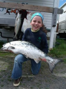 girl holding fish across her lap