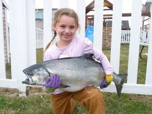little girl holding fish
