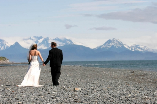 Bride and Groom walkin on beach