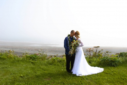 bride and groom on bluff