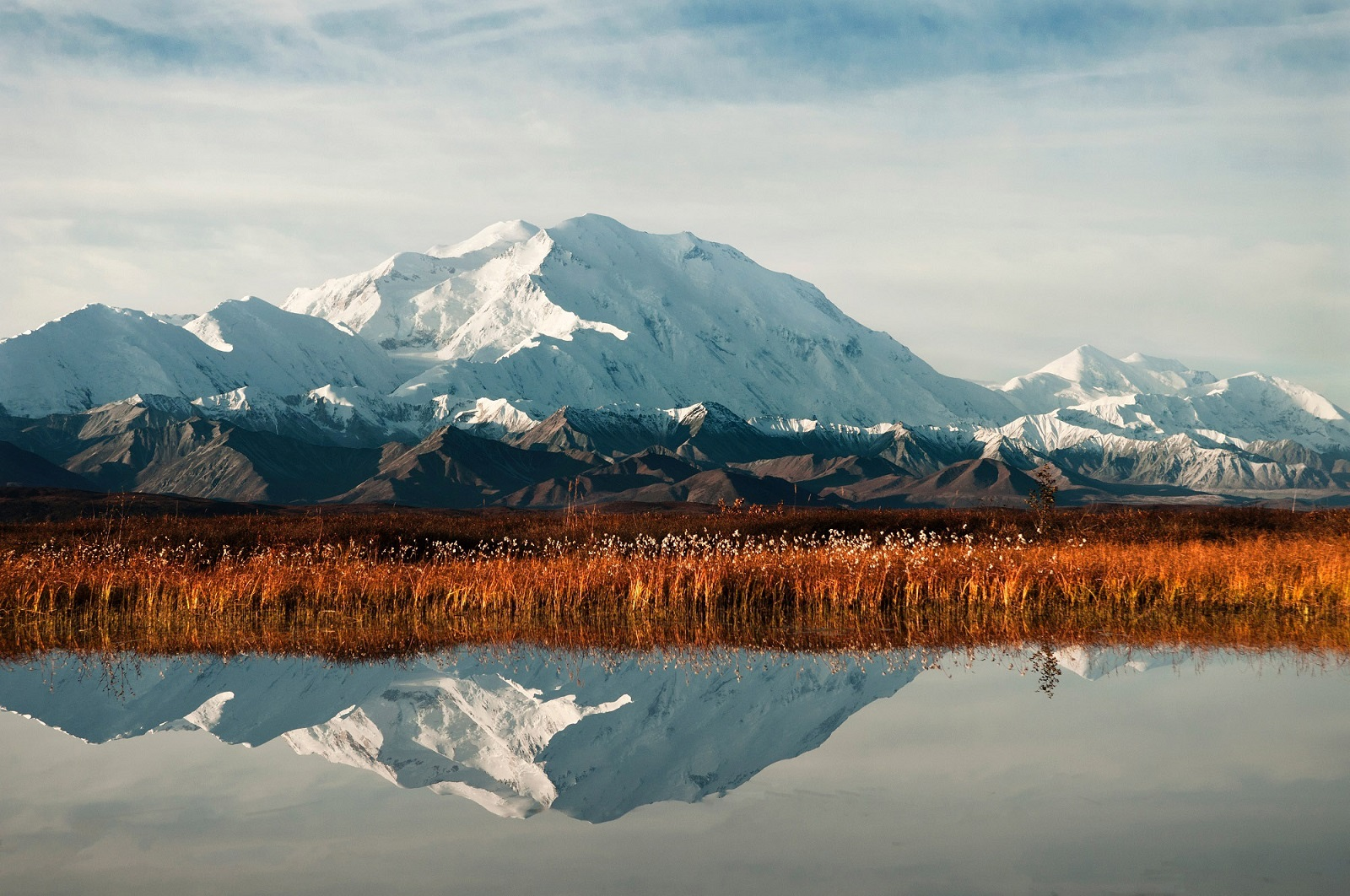 view of mountains reflected in the water