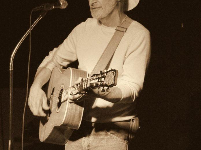 Hobo Jim playing on acoustic guitar