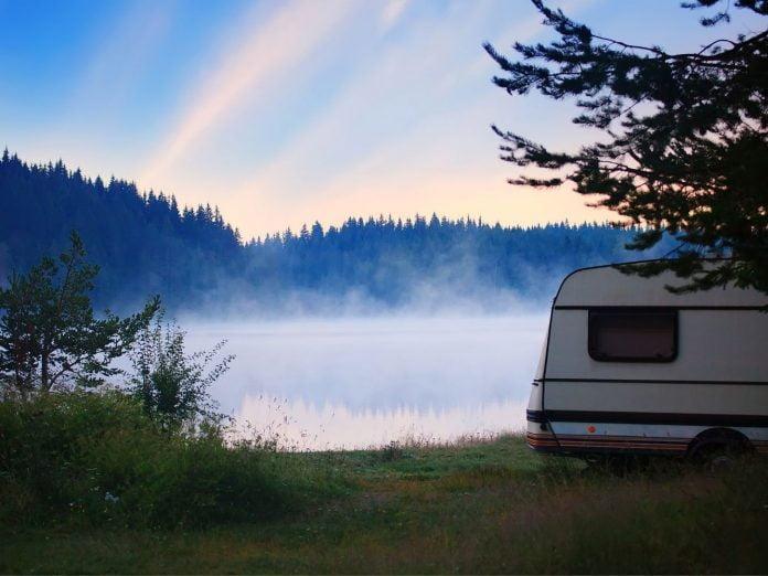 RV parked beside a lake in Alaska.