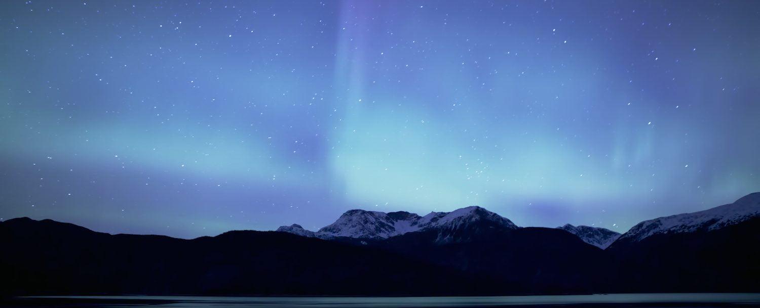 Northern lights (Aurora Borealis) over the mountains near Haines Alaska.